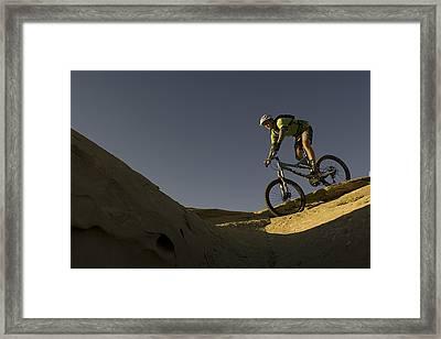 A Caucasian Man Mountain Biking Framed Print by Bobby Model