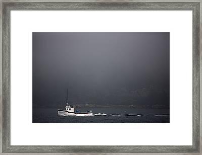A Fishing Boat Motors Through The Fog Framed Print by Pete Ryan