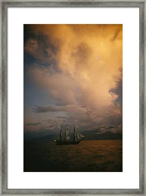 A Tall Ship, Sails Full Of Wind, Passes Framed Print by Luis Marden