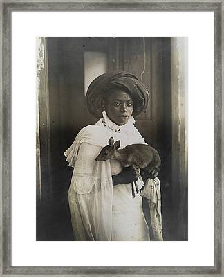 A Young Kenyan Woman Holds Her Pet Deer Framed Print by Underwood And Underwood