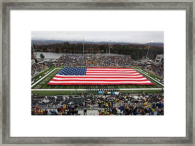 Army An American Flag Spans Michie Stadium Framed Print by Associated Press