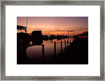 Boats And Houses At Sunset Framed Print
