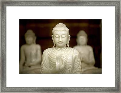 Buddha Statuettes At The Temple Framed Print by David Evans