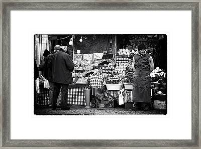 Buying Fruit Framed Print by John Rizzuto