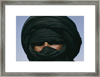 Close View Of A Turbaned Tuareg Man Framed Print by Thomas J Abercrombie