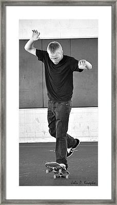 Determination Framed Print by John Knapko