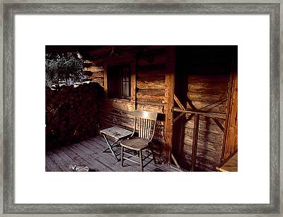 Firewood And A Chair On The Porch Framed Print