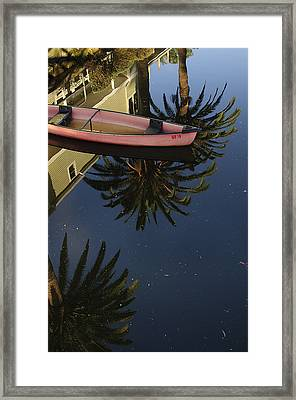 Floating On Palms Framed Print by Kevin Bergen