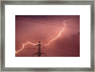 Lightning Hitting An Electricity Pylon Framed Print by Peter Lawson