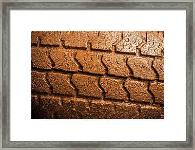 Muddy Tire Framed Print