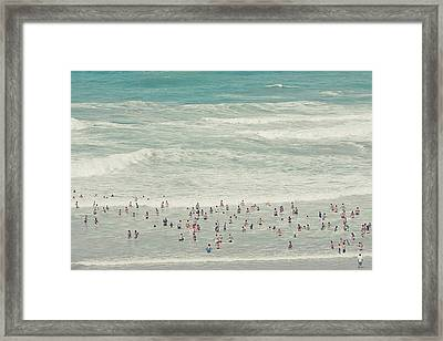 People Walking Into Ocean Framed Print by Cindy Prins