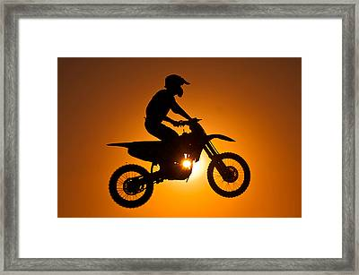 Silhouette Of Motocross At Sunset Framed Print