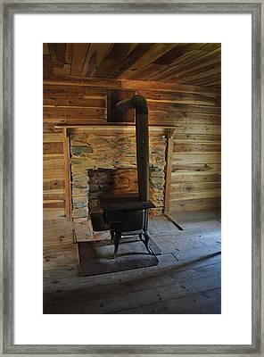Stove In A Cabin Framed Print by Jeff Moose