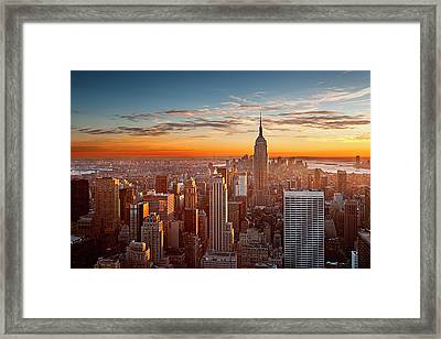 Sunset Over Manhattan Framed Print by Inigo Cia