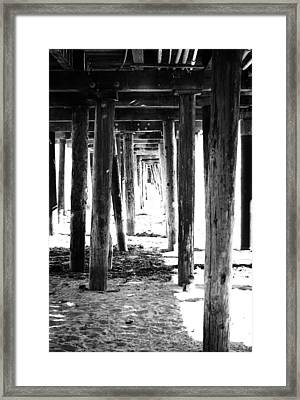 Under The Pier Framed Print by Linda Woods