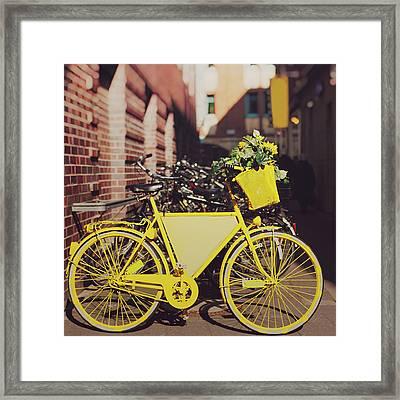 Yellow Bike Framed Print by Julia Davila-Lampe