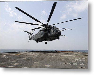 An Mh-53e Sea Dragon Prepares To Land Metal Print by Stocktrek Images