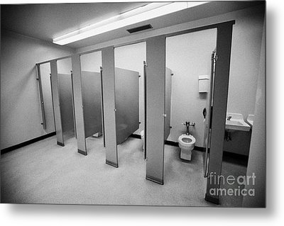 cubicle toilet stalls in womens bathroom in a High school canada north america Metal Print by Joe Fox