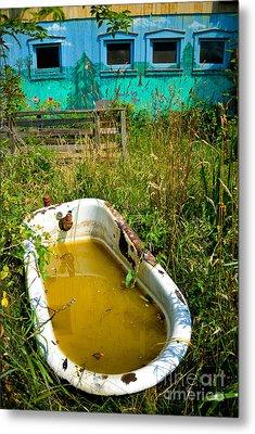 Old Bathtub Near Painted Barn Metal Print by Amy Cicconi