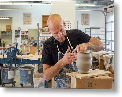 Potter At Work Metal Print