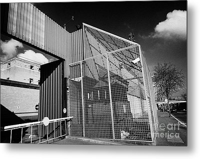 anti rpg cage surrounding observation sanger at North Queen Street PSNI police station Belfast North Metal Print