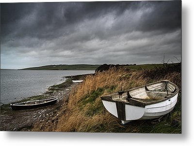 Old Decayed Rowing Boats On Shore Of Lake With Stormy Sky Overhe Metal Print by Matthew Gibson