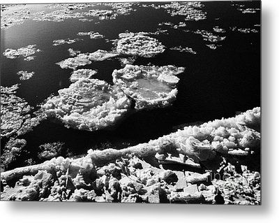 large chunks of floating ice on the south saskatchewan river in winter flowing through downtown Sask Metal Print by Joe Fox
