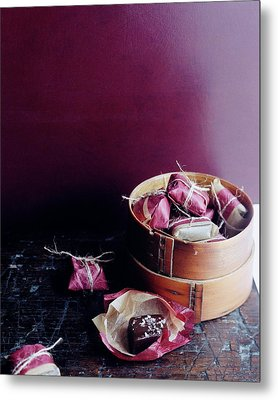 A Bamboo Steamer With Paper Packages Metal Print
