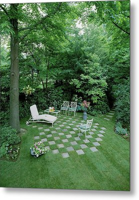 A Garden With Checkered Pavement Metal Print