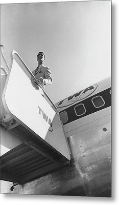 A Male Model Disembarking A Twa Boeing 707 Plane Metal Print by Leonard Nones
