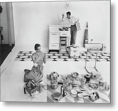 A Married Couple With Kitchen Appliances Metal Print by Herbert Matter