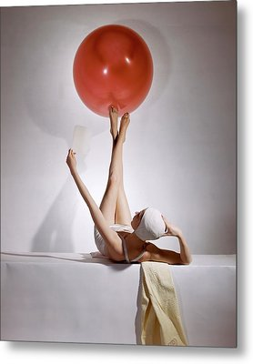 A Model Balancing A Red Ball On Her Feet Metal Print by Horst P. Horst