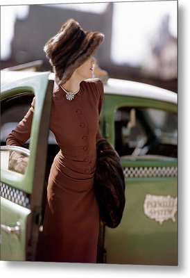 A Model Getting Out Of A Cab Metal Print by Constantin Joffe