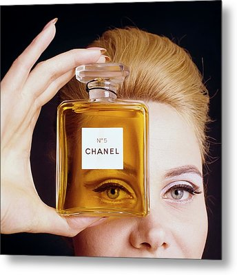 A Model Holding A Bottle Of Perfume Metal Print by Fotiades