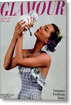 A Model Holding A Kitten Metal Print by Gjon Mili
