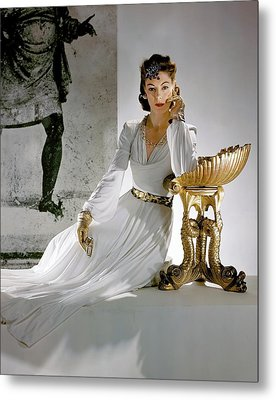 A Model Leaning On A Gold Pedestal Metal Print