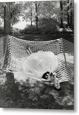 A Model Lying On A Hammock Metal Print by Gene Moore
