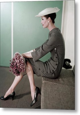 A Model Sitting Down With A Bouquet Of Flowers Metal Print