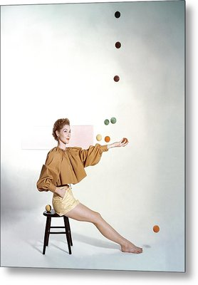 A Model Sitting On A Stool Juggling Metal Print
