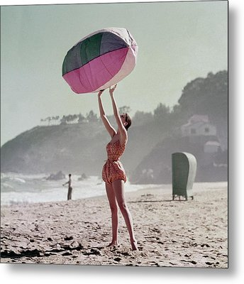 A Model Wearing A Bathing Suit Holding Up An Metal Print by Richard Rutledge