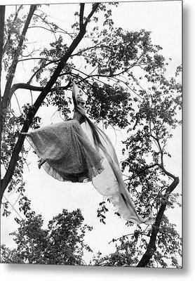 A Model Wearing A Dress In A Tree Metal Print