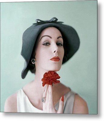A Model Wearing A Hat And Holding A Flower Metal Print by Karen Radkai