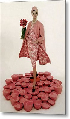 A Model Wearing A Matching Pink Outfit Holding Metal Print by William Bell