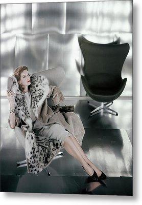 A Model Wearing A Snow Leopard Coat Metal Print