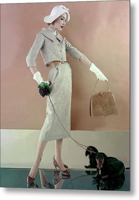 A Model Wearing A Tweed Jacket And Skirt Metal Print by Karen Radkai