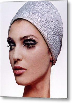 A Model Wearing Dark Eye Make-up Metal Print by Bert Stern