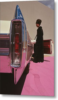 A Model Wearing Emeric Partos Entering A 1965 Metal Print by Gene Laurents
