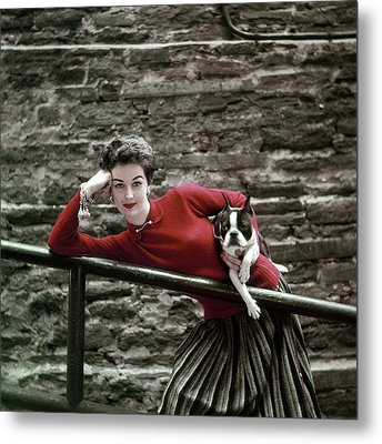 A Model With A Dog Leaning On A Railing Metal Print by Richard Rutledge
