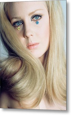 A Model With Flowers Under Her Eyes Metal Print by Franco Rubartelli