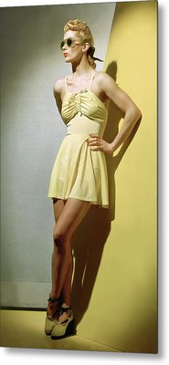 A Portrait Of Lisa Fonssagrives In A Yellow Metal Print by Horst P. Horst